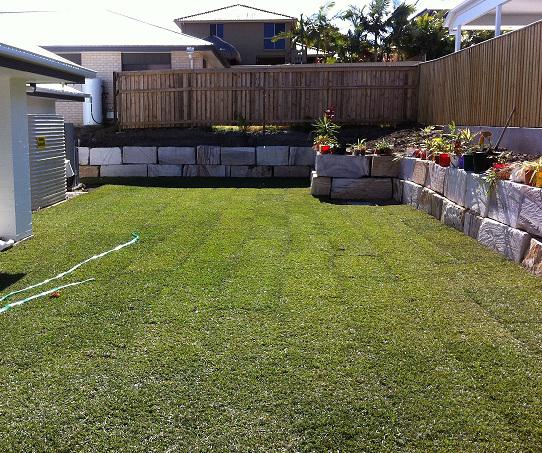 This New Backyard Was Completed With 1m High Cut Sandstone Block Walls On  The Boundaries And Finished With The Whole Area Being Turfed.